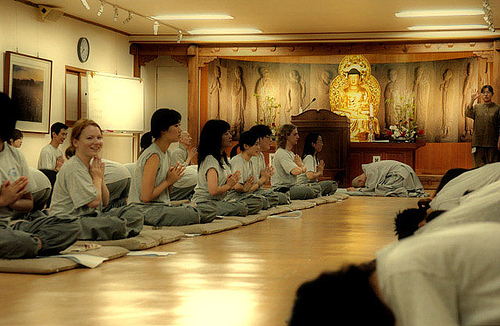 Temple Stay guests are instructed in the proper etiquette for bowing at Kilsangsa temple in Seoul, South Korea.